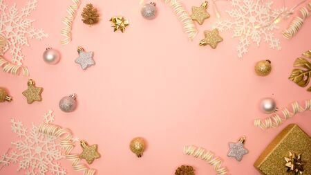 2020 Christmas and new year background banner with the beautiful decor open gift for holiday in winter. On bright pink, golden and silver color theme with snow flake. top view with copy space.