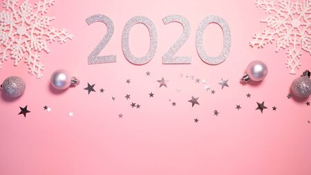 2020 Christmas and new year background banner with the beautiful decor gift for holiday in winter. On bright pink, golden and silver color theme with snow flake. top view with copy space.