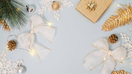 2020 Christmas and new year background banner with the beautiful decor gift for holiday in winter. On bright blue, golden and silver color theme with snow flake. top view with copy space.