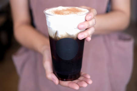 barista hold and serve the ice with cream