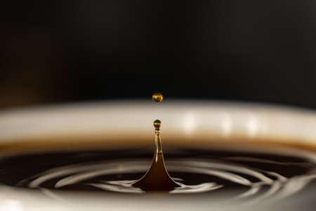 coffee splash and drop . macro close up brown liquid with smoke.
