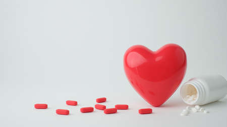 red heart on white background . symbol of love, care ,health and organ donor.