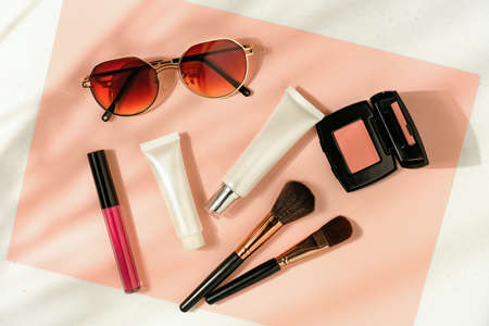 Beauty cosmetic product on flatlay background . Skincare for summer and travel. Zdjęcie Seryjne