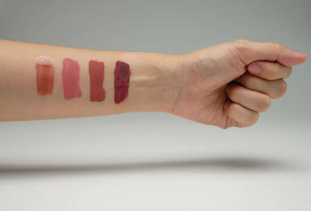 make up and lipstick swatch and shade on hand . beauty and cosmetic content. Imagens
