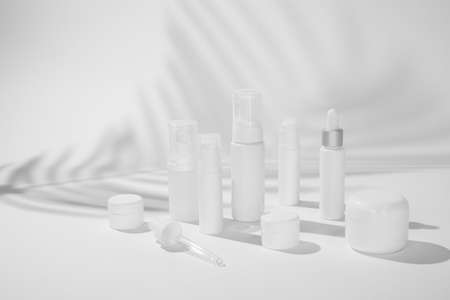 cosmetic and skin care package on white background with shadow. modern and minimal beauty product design.