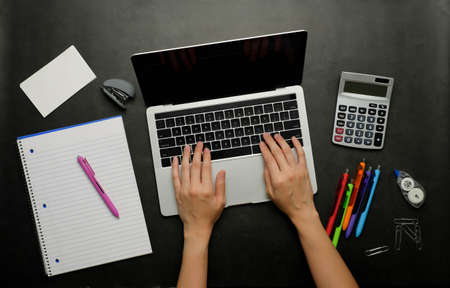 the person analyzing financial data.office and study stationery with a laptop for online work and back to school. Zdjęcie Seryjne - 156578345