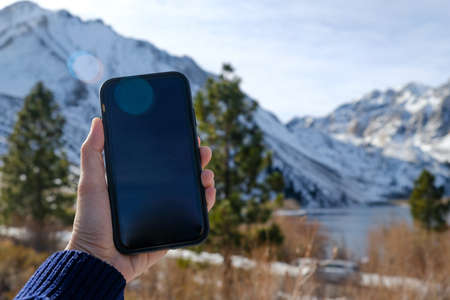 mobile phone and snow weather in the mountain.