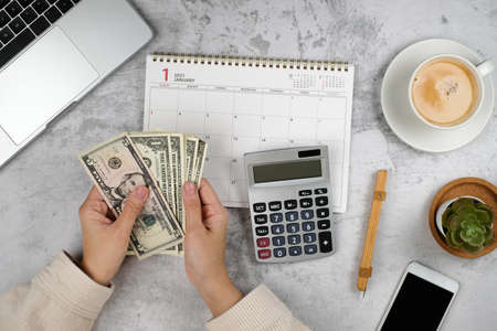 money planner and calendar for2021. financial and investment plan for retirement and saving. usd bills. Imagens - 162560817
