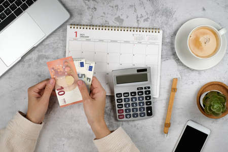 money planner and calendar for2021. financial and investment plan for retirement and saving.euro bills.