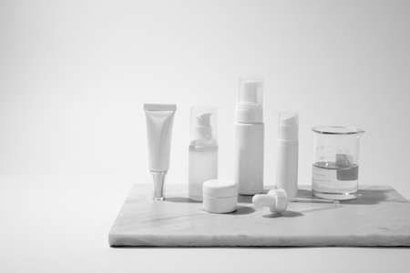 cosmetic and skin care for beauty routine on white background with shadow. modern and minimal product design with essential oil, pestle and mortar. 版權商用圖片