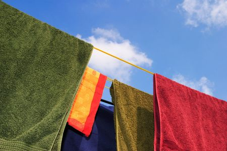 laundry line: Brightly colored washing on a clothes line Stock Photo