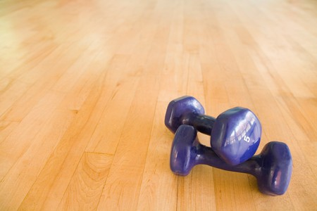 Pair of dumbbells on the floor of a fitness studio with copy space Stock Photo