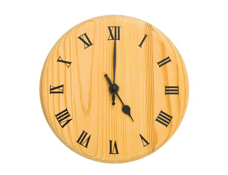 timekeeping: Wooden clock face isolated on white Stock Photo