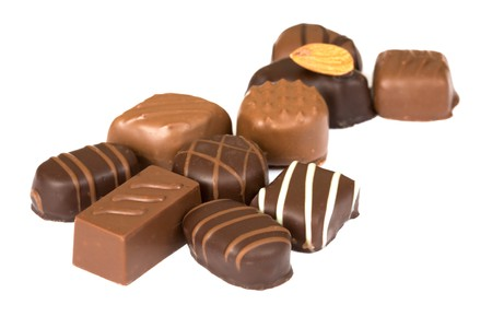 sinful: Individual chocolates isolated on a white background
