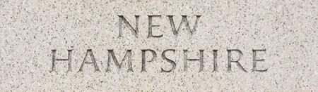 New Hampshire state name written in grey granite stone photo