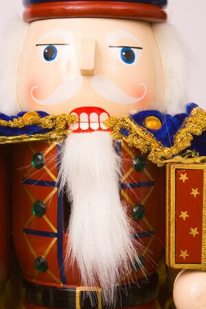 A traditional Christmas nutcracker ornament isolated on white photo