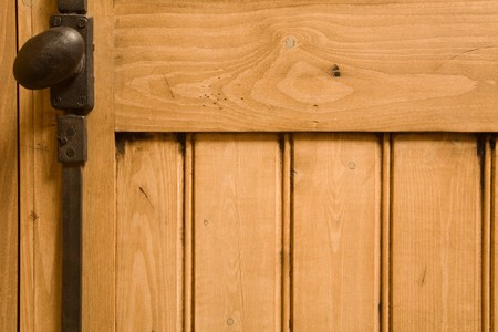 Detail of wooden panelled furniture with iron handle Stock Photo - 4433699
