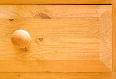 Detail of pine chest of drawers photo