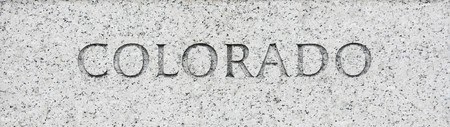 Colorado state name written in grey granite stone photo