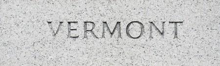 Vermont state name written in grey granite stone photo