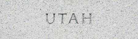 Utah state name written in grey granite stone photo