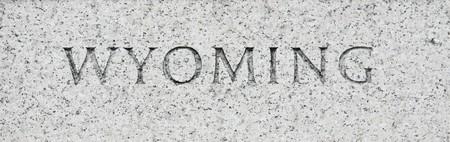 Wyoming state name written in grey granite stone photo