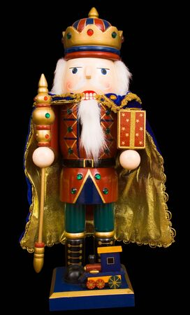 A traditional Christmas nutcracker ornament isolated on black Stock Photo - 4480369