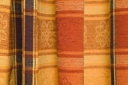 Detail of a tartan pattern in pleated fabric. photo