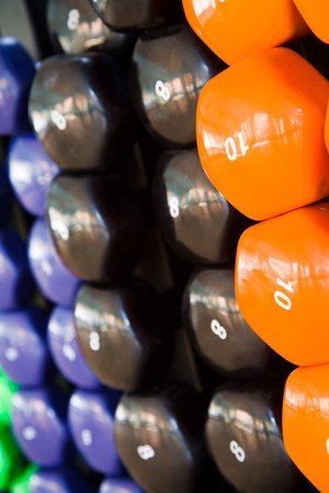 Closeup of multicolored dumbbells in a fitness studio photo