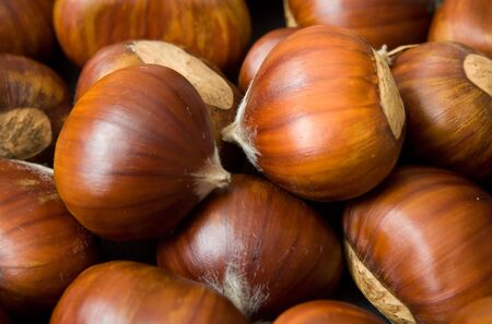 loads: Closeup of a pile of sweet chestnuts