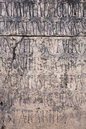 Detail of Roman engraved writing on stone photo