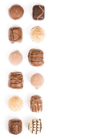 whitespace: Border of individual chocolates isolated on white with copy space