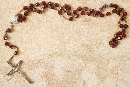 Rosary beads on a sandstone background with space for text Stock Photo - 4881502