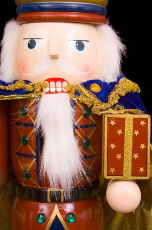 A traditional Christmas nutcracker ornament isolated on black photo