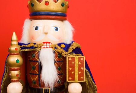 A traditional Christmas nutcracker ornament isolated on red Stock Photo - 4881509