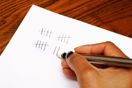 tally: Tally marks being written on paper