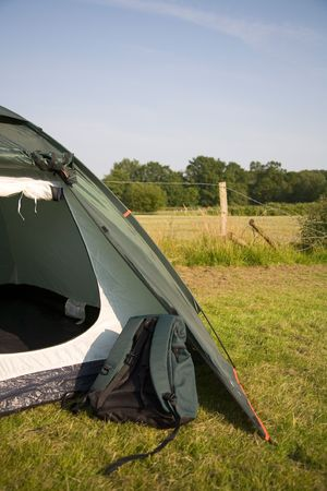 overnight stay: A rucksack and tent pitched in the New Forest, England