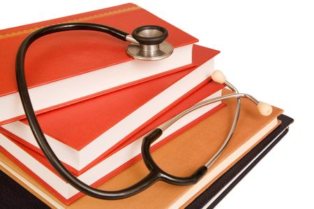 Stethoscope on a stack of reference books isolated on white Stock Photo - 5198940