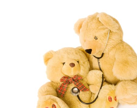 pediatrics: Teddy bears with stethoscope posing as doctor and patient. Ideal to illustrate pediatrics.