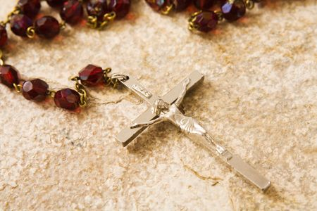 Rosary beads on a sandstone background photo