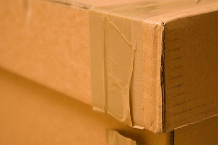 Detail of a cardboard box with packing tape photo