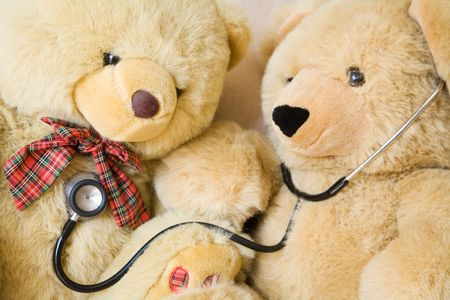 paediatrics: Teddy bears with stethoscope posing as doctor and patient. Ideal to illustrate paediatrics. Stock Photo