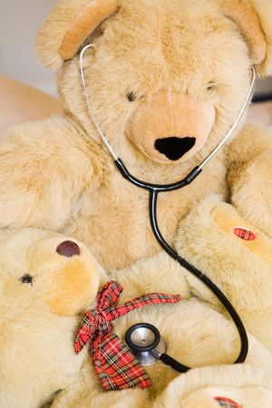 down beat: Teddy bears with stethoscope posing as doctor and patient. Ideal to illustrate paediatrics. Stock Photo