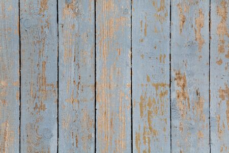 Distressed paintwork on wood, ideal for a grunge background photo