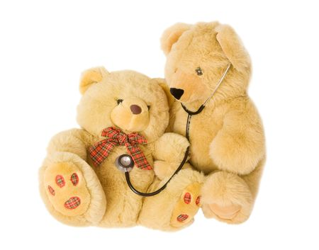 Teddy bears with stethoscope posing as doctor and patient. Ideal to illustrate paediatrics. photo