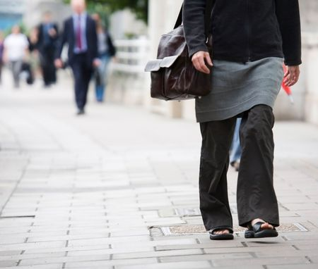 Commuters in casual business dress walk to work photo