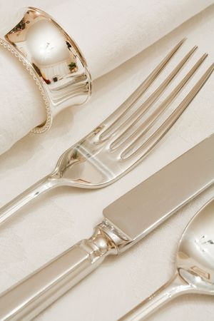 banqueting: Place setting close-up with napkin on damask tablecloth Stock Photo