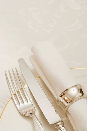 cropped out: Place setting with cutlery, plate and napkin with copyspace