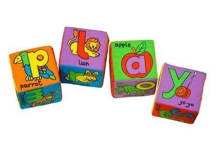 Alphabet blocks isolated on white spelling the word play photo