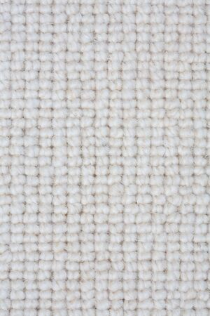 rug weaving: Detail of a light colored carpet ideal for a textured background